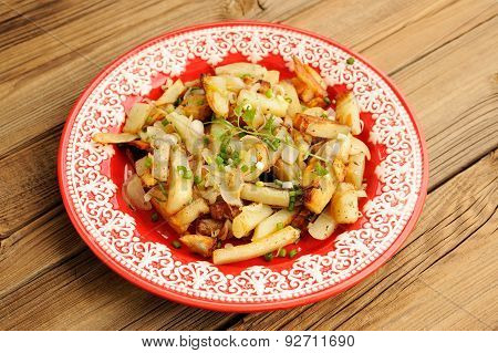 Fried Potatoes With Scallion In Red Plate