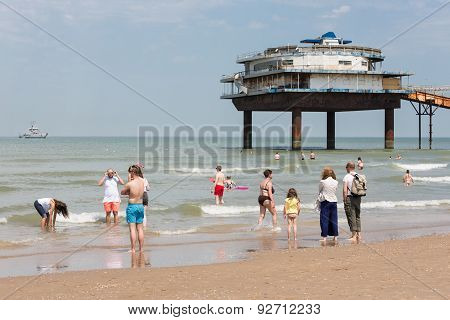 Seaside Visitors At Dutch Beach Near Pier Of Scheveningen