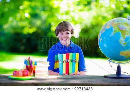 Child Studying In School Yard.