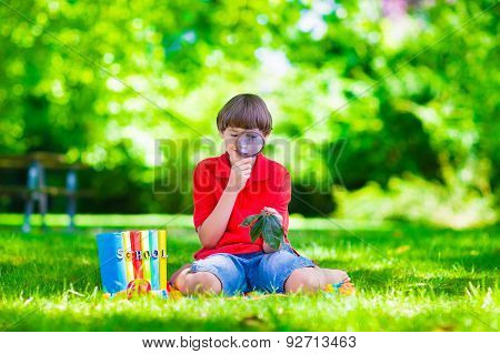Child In School Yard With Magnifying Glass