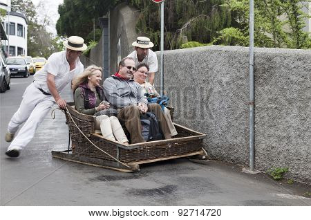 FUNCHAL, MADEIRA - MAY 20: Traditional downhill sledge trip on May 20, 2015 in Madeira, Portugal. Sl