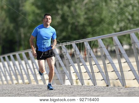 Young Athletic Man Practicing Running And Sprinting On Urban City Park Background In Sport Training