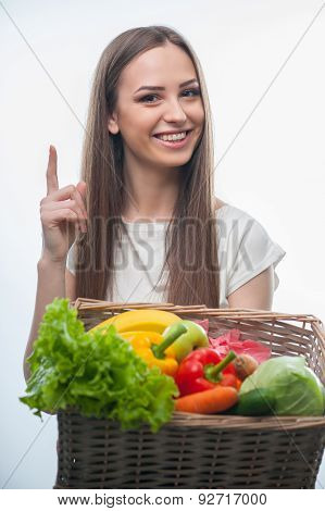 Cheerful young lady with vegetables and fruits