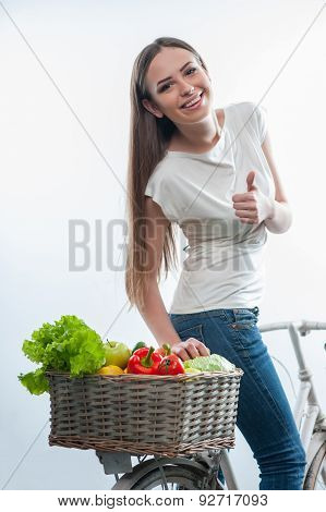 Beautiful healthy woman with vegetables and fruits
