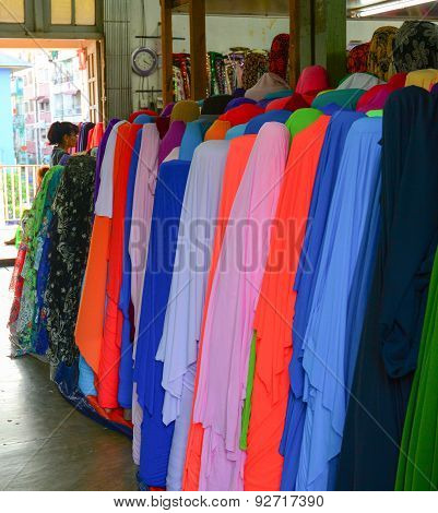 Many Colorful Reels Of Textile At Market
