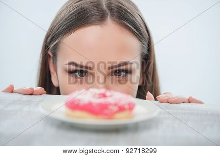 Pretty young woman wants to eat sweet food