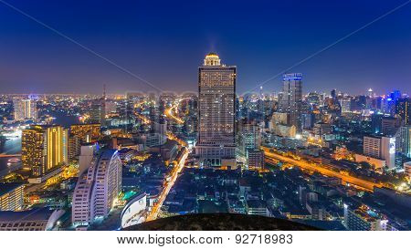 Landscape of Bangkok city at night with bird view