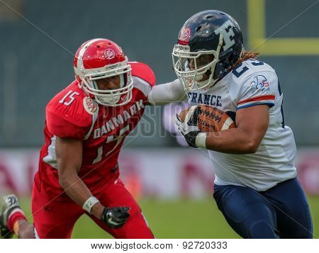 GRAZ, AUSTRIA - JUNE 2, 2014: RB Nguendjo Stephen Yepmo (#23 France) runs with the ball.