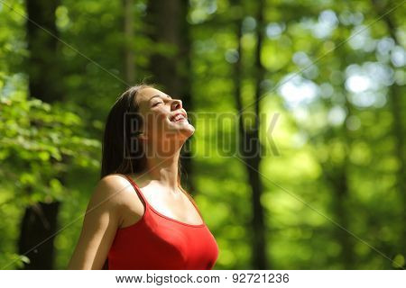 Woman Breathing Fresh Air In The Forest
