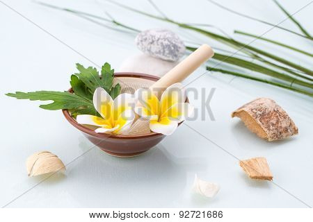 Spa Concept With Mortar And Pestle, Flowers, Leaf And Stone