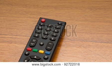 Tv Remote On The Wooden Desk