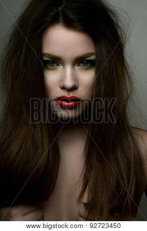 Beauty Fashion Model With Red Lips And Hands On Breasts