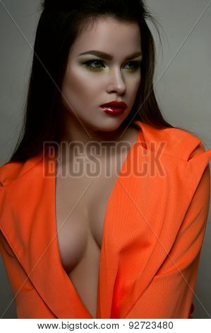Fashion Beauty Female Model With Big Breasts In Orange Jacket