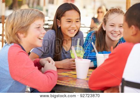 Group Of Children Hanging Out Together In Caf\x81_