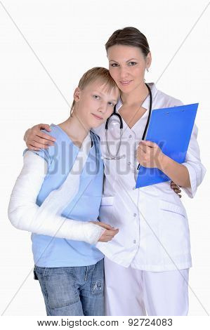 Doctor and young boy with a broken arm