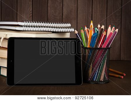 Stack Of Books, Digital Tablet And Pencils