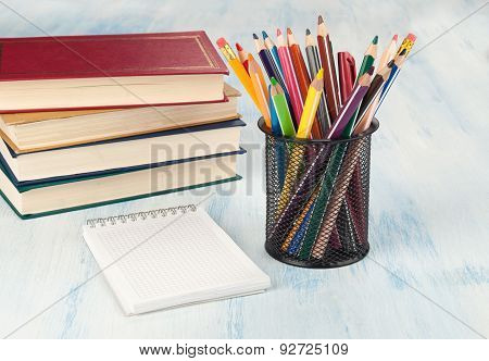 Notebook Stack And Pencils. School Supplies