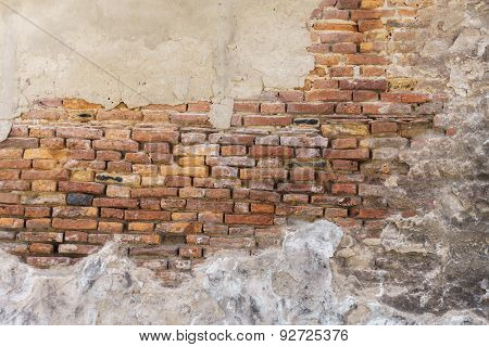 Old Brick Wall And Plaster Peel Off