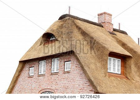 House With A Thatched Roof On A White Background