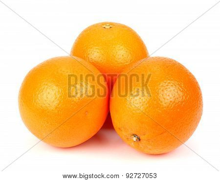 Three Ripe Oranges On A White Background