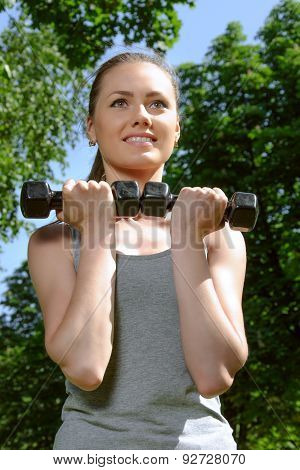 Sports Woman Doing Exercises With Lightweight Dumbbells