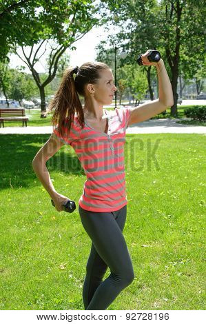 Fitness Female Doing Exercises With Lightweight Dumbbells