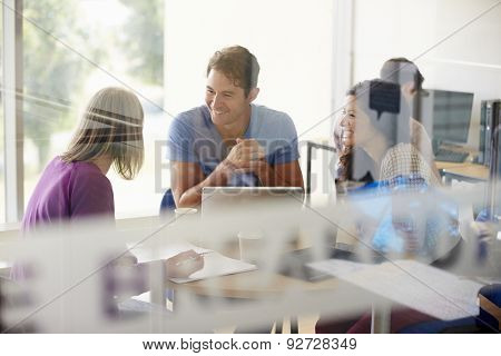 Mature Students Working In College Breakout Area