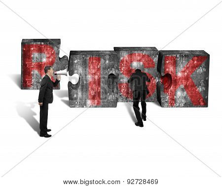 Businessman Speaker Yelling Other Pushing Jigsaw Blocks Red Risk Word