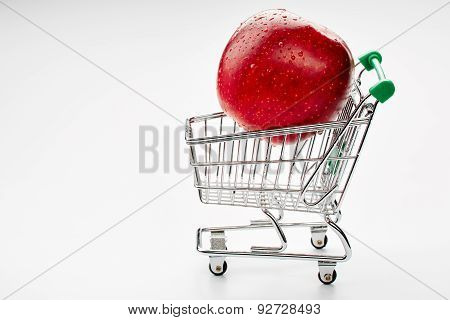 Shopping cart with red apple