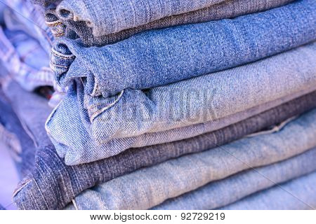 Stack Of Blue Jeans Background.