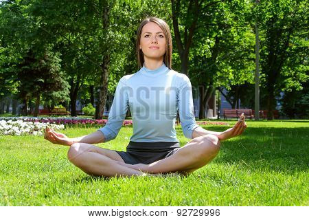 Yoga Woman Meditates In The Lotus Position