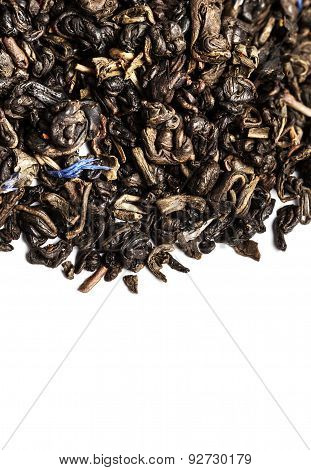 ..aromatic Black Dry Tea Leaf With Petals Background Close Up.