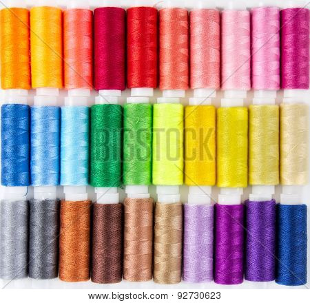 Background From Bobbins With Multicolored Thread
