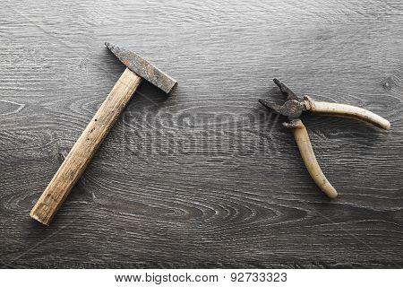 tools on wood panel background