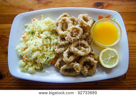 Rice, squids and citrus juice.