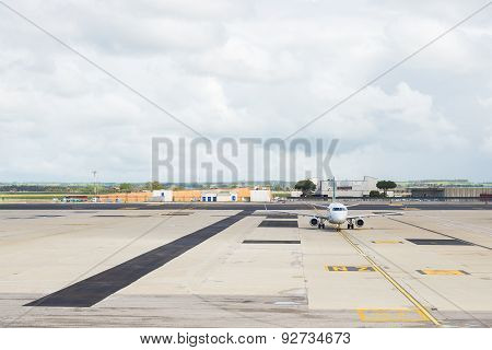 Commercial Airplane On Parking Strip At Airport