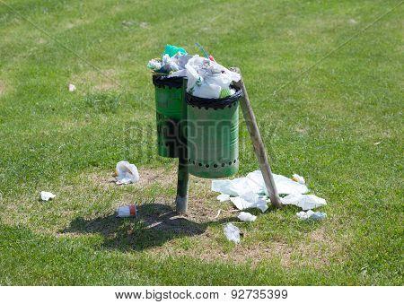 Trash Bin Full In An Outdoor Park