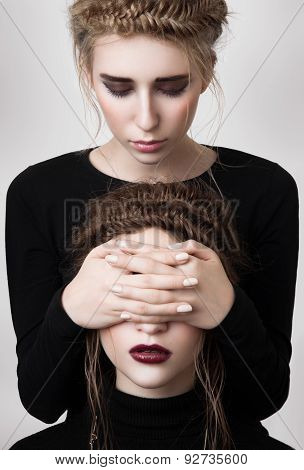 Fashion Blonde Girl Cover Eyes Of Brunette