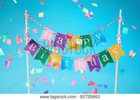 Happy birthday sign over confetti background