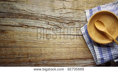 Wooden bowl ,fork and spoon on wooden background