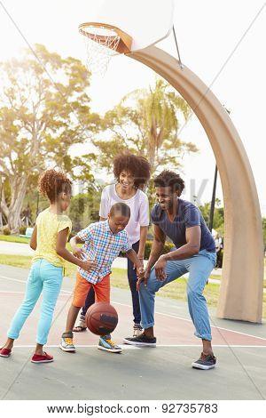 Family Playing Basketball Together