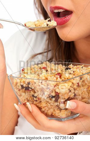 Young Woman Eating Cereal Breakfast