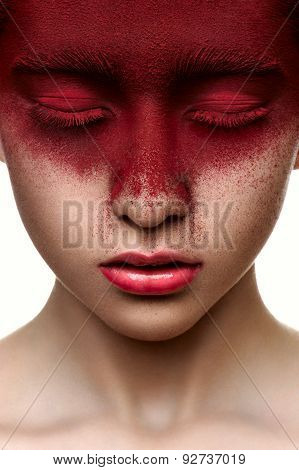 Red Paint On Face Of Beauty Model