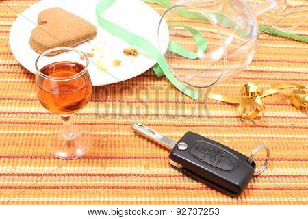 Car Key With Glass Of Wine On Table After Party