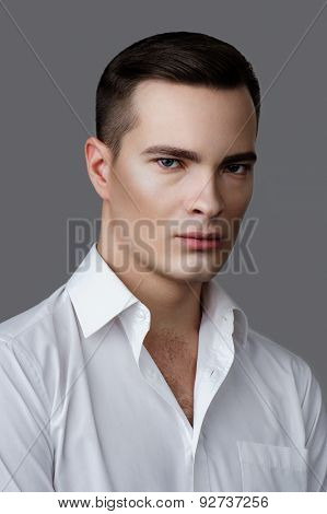 Fashion Beauty Man In White Shirt On Gray Background