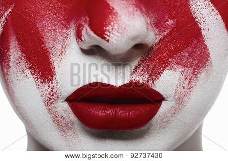 Halloween Bloody Makeup. Closeup Red Lips And Blood On Skin
