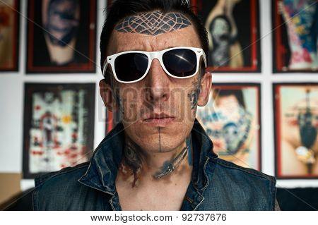 Tattooist In Denim Vest And Sunglasses