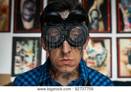 Portrait Of Tattoo Artist In Welder Glasses