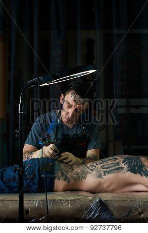 Tattoo Master Creates A Design Of Tattoo
