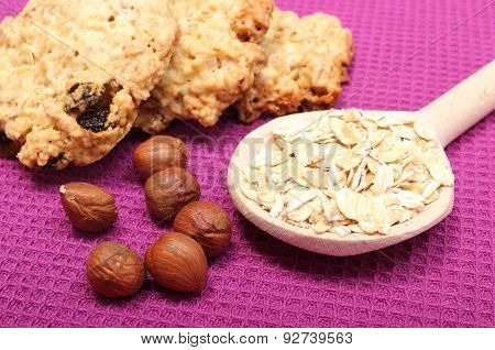 Oatmeal Cookies With Flakes And Hazelnut On Purple Background